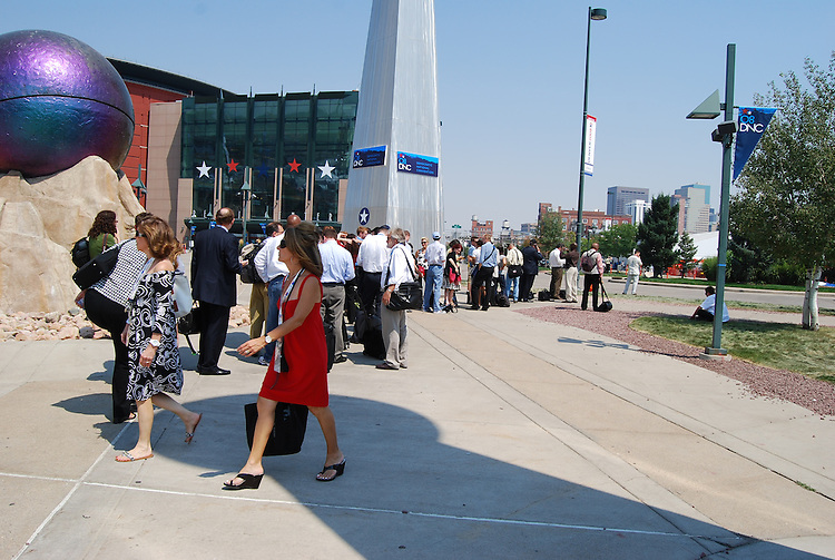Media members begin to line up around noon for the shuttle ride to Invesco Field. About an hour later, nearly 300 are in line. It's about a 25-minute walk, including over a highway, otherwise. (Lauren Phillips, Congressional Quarterly Inc.)