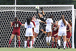 14 August 2014: South Carolina's Sabrina D'Angelo (CAN) (34) knocks the ball into the net under pressure from Duke's Danielle Duhl (23) for a Duke own goal. The Duke University Blue Devils hosted the University of South Carolina Gamecocks at Koskinen Stadium in Durham, NC in a 2014 NCAA Division I Women's Soccer preseason match. Duke won the exhibition 2-0.