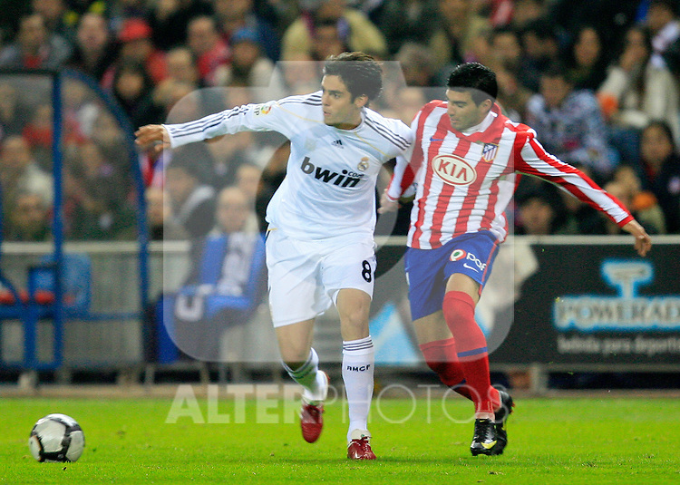 Real Madrid's Kaka (l) and Atletico de Madrid's Jose Antonio Reyes during La Liga match. November 7 2009. .(ALTERPHOTOS/Acero).
