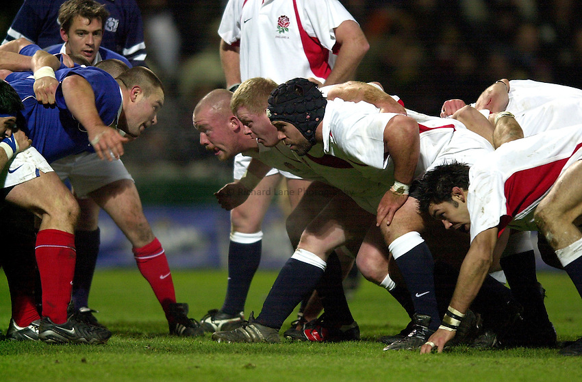 Photo. Richard Lane.England A v France A at Franklin Gardens, Northampton. 14/02/2003.England front row, Robbie Morris, Dorian West and Michael Worsley.