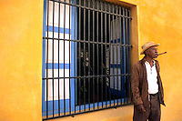 Man with Cigar Yellow Walls Old Havana , Cuba