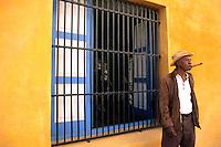Man with Cigar Yellow Walls Old Havana , Cuba