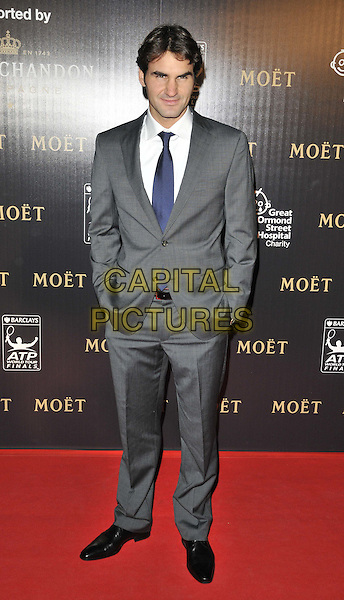 Roger Federer.attended the Barclays ATP World Tour Finals official launch party, Battersea Power Station, Cringle St., London, England, UK, 17th November 2011..full length grey gray suit  blue tie white shirt hands in pockets .CAP/CAN.©Can Nguyen/Capital Pictures.