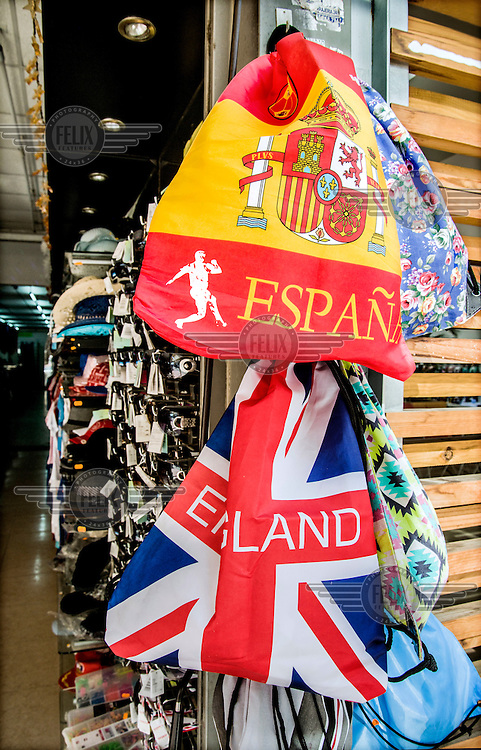 Cheap beach bags printed with the Spanish and British flags (the British one mistakenly says 'England') for sale in a shop on Avenida Rei Jaume I, in Benidorm