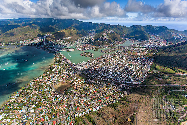 An aerial view of Hawai'i Kai that includes Haha'ione Valley, Maunalua Bay, Koko Marina, Kuapa Pond and the Portlock neighborhood, Honolulu, O'ahu.