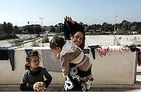 Pictured: Refugees inside the Helliniko camp Friday 26 February 2016<br /> Re: Refugees have been turning up at the Helliniko refugee camp in the outskirts of Athens, Greece.