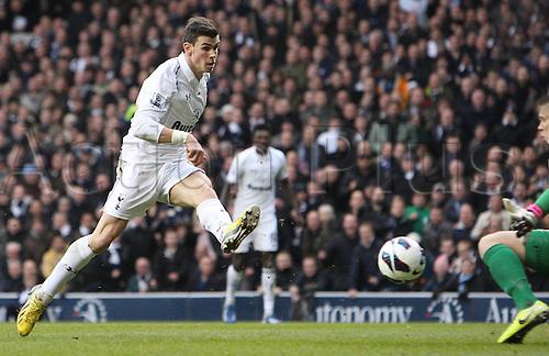 03.03.2013. London, England. Gareth Bale of Tottenham Hotspur scores the games opeing goal during Premier League game between Tottenham Hotspur and Arsenal from White Hart Lane
