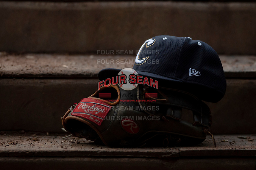 A Cougars hat rests on a Rawlings glove during a Midwest League game between the Kane County Cougars and Cedar Rapids Kernels at Northwestern Medicine Field on April 28, 2019 in Geneva, Illinois. Kane County defeated Cedar Rapids 3-2 in game two of a doubleheader. (Zachary Lucy/Four Seam Images)