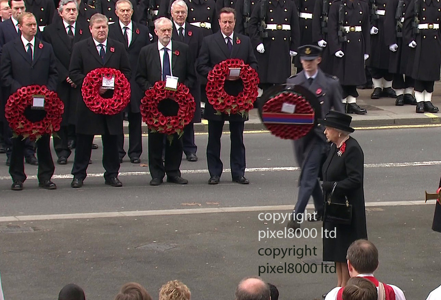 Pic shows: Cenotaph  Remembrance Sunday<br /> <br /> Jeremy Corbyn lines up with David Cameron and other politicians<br /> He is wearing a poppy but forgets to do up his jacket. Upon noticing he does it up as the queen is handed her wreath to lay<br /> <br /> <br /> Picture by Pixel8000 07917221968
