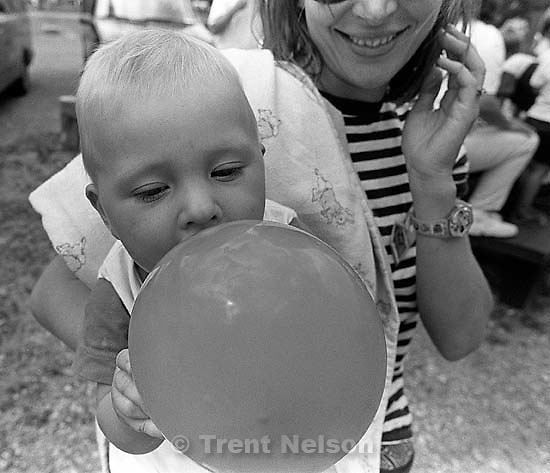 Noah Nelson sucks on balloon, Laura Nelson at the Robinsion reunion.<br />