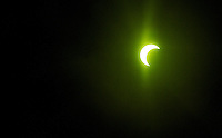 Moon eclipsing the sun May 20, 2012 shot through a welding helmet lens, thus the green color.