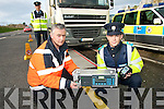 ON DUTY: Sean Barry, Road Safety Officer with Kerry County Council and Garda Barry Cullhane of Tralee Garda Station checking out the weight of a truck on the Mobile Weigh Bridge on the Killarney Road outside Tralee on Thursday last.    Copyright Kerry's Eye 2008