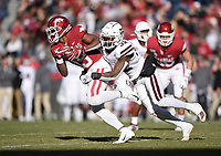 NWA Democrat-Gazette/CHARLIE KAIJO Arkansas wide receiver Tyson Morris (19) carries the ball as Mississippi State safety Brian Cole II (32) tackles, Saturday, November 2, 2019 during the second quarter of a football game at Donald W. Reynolds Razorback Stadium in Fayetteville. Visit nwadg.com/photos to see more photographs from the game.
