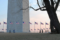 Spectators walk by the Washington Monument on their way to the inauguration of Barack Obama as the 44th President of the United States, Tuesday, Jan. 20, 2009, in Washington, D.C. (Ryan Rayburn/pressphotointl.com)