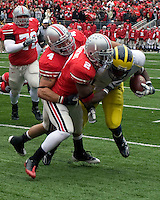 November 22, 2008. Ohio State defensive backs Kurt Coleman (4) and Malcolm Jenkins (2) stop Michigan running back Brandon Minor short of the goalline. The Ohio State Buckeyes defeated the Michigan Wolverines 42-7 on November 22, 2008 at Ohio Stadium, Columbus, Ohio.