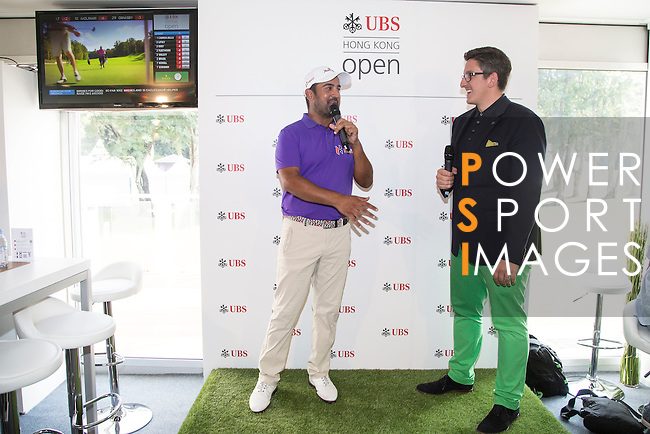 Shiv Kapur of India visits the UBS Pavilion and gives an yearbook autographed by players to UBS CEO Amy Lo on the sidelines of the 58th UBS Hong Kong Golf Open as part of the European Tour on 10 December 2016, at the Hong Kong Golf Club, Fanling, Hong Kong, China. Photo by Vivek Prakash / Power Sport Images