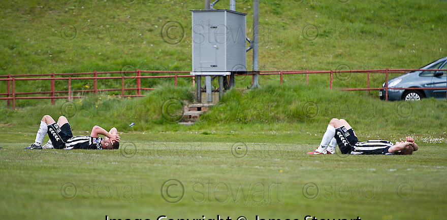 Elgin players are distraught at the end of the game after losing the play off semi final .....