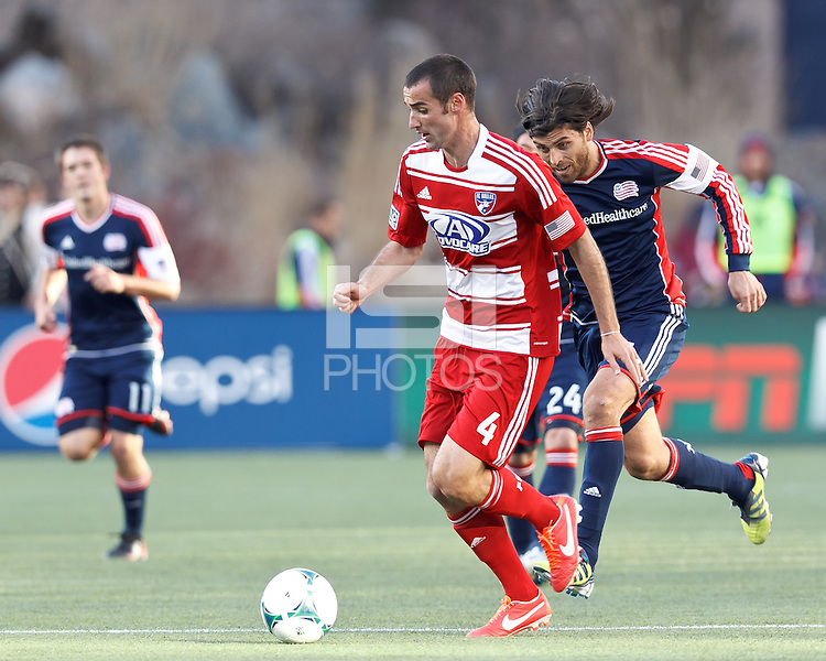 FC Dallas midfielder Andrew Jacobson (4) dribbles as New England Revolution forward Juan Toja (7) closes,.  In a Major League Soccer (MLS) match, FC Dallas (red) defeated the New England Revolution (blue), 1-0, at Gillette Stadium on March 30, 2013.