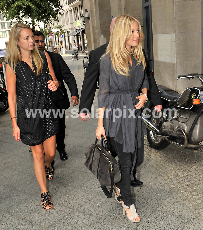 **ALL ROUND EXCLUSIVE PICTURES FROM SOLARPIX.COM**.**SYNDICATION RIGHTS FOR UK AND SPAIN ONLY**.Sienna Miller on the way to TV station Sat-1 during 2009 Mercedes Benz Fashion Week in Berlin, Germany. 02 July 2009..This pic: Sienna Miller..JOB REF: 9403 CPR (Grimm) DATE: 02_07_2009 .**MUST CREDIT SOLARPIX.COM OR DOUBLE FEE WILL BE CHARGED**.**ONLINE USAGE FEE GBP 50.00 PER PICTURE - NOTIFICATION OF USAGE TO PHOTO @ SOLARPIX.COM**.**CALL SOLARPIX : +34 952 811 768 or LOW RATE FROM UK 0844 617 7637**