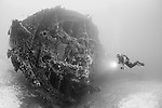 Divers exploring the wreck of the Vassilios T. which lies between 20 and 55 metres