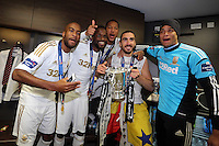Pictured L-R: Swansea players Dwight Tiendalli, Roland Lamah, Jonathan de Guzman, Chico Flores and Michel Vorm celebrating with the cup in the changing rooms after the game.  Sunday 24 February 2013<br /> Re: Capital One Cup football final, Swansea v Bradford at the Wembley Stadium in London.