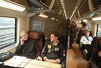 """- passengers on board the high speed train  Eurostar """"Red Arrow"""" on the Milan-Bologna railway line....- passeggeri a bordo del treno ad alta velocità Eurostar """"Freccia Rossa"""" sulla linea Milano-Bologna"""