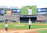 Hideki Matsui,<br /> JULY 28, 2013 - MLB :<br /> Hideki Matsui tips his cap to fans after throwing out the ceremonial first pitch as New York Yankees starting pitcher Phil Hughes and catcher Chris Stewart look on during Matsui's official retirement ceremony before the Major League Baseball game against the Tampa Bay Rays at Yankee Stadium in The Bronx, New York, United States. (Photo by AFLO)