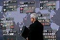 A man passes next to the stock market indicator board on April 22, 2015, Tokyo, Japan. The Japan stock market broke 20,000 yen during the morning trading session of the Tokyo Stock Exchange. (Photo by Rodrigo Reyes Marin/AFLO)