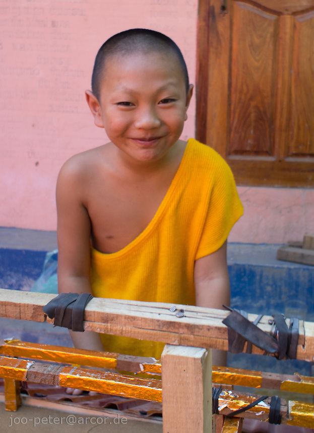 young monk in monastery, Luang Prabang, Laos, 2012