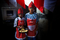 11 year old Mohamad Kusworo and 12 year old Sean Prayoga, students at Kartini Emergency School, show their competition winning pizza made at the school to celebrate Indonesian Independence Day. Since the early 1990s, twin sisters Sri Rosyati (known as Rossy) and Sri Irianingsih (known as Rian) have used their family inheritance to set up and run 64 schools in different parts of Indonesia, providing primary education combined with practical skills to some of the country's most deprived children. .