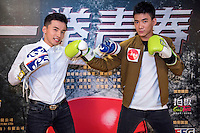 Launch of the MMA movie 'Fist of Youth' in Hong Kong. Stars of the movie L to R A-Wei (Liu Jun Wei) from Lollipop F a Taiwanese Mandopop boy band and MMA actor Jason Li Zongyan. Hong Kong on August 26, 2016