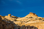 Colorful hoodoos, or rock formations, on the top of a Navajo Sandstone mesa in the Head of Sinbad area of the San Rafael Swell in Utah.