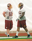 Offensive linemen Spencer Long (60), left, of Nebraska and Morgan Moses (76) of Virginia, right, both of whom were drafted in the third round of the recent NFL draft, participate in the Washington Redskins' rookie minicamp at Redskins Park in Ashburn, Virginia on Saturday, May 17, 2014.<br /> Credit: Ron Sachs / CNP