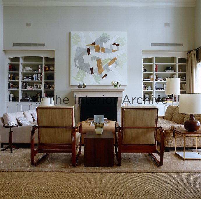 A pair of Viennese vintage 1940s armchairs mix with contemporary sofas infront of the fireplace in the living room
