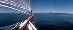 A panoramic 6x17 view off a schooner's bowsprit towards a the San Juan Islands