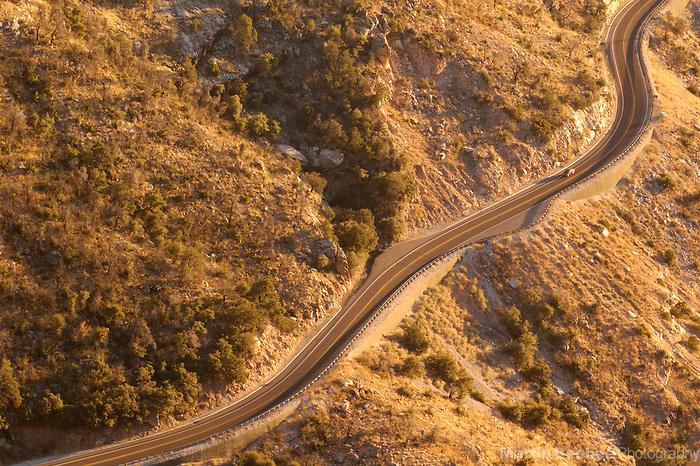 Car driving on a winding road in the Santa Catalina Mountains, Coronado National Forest, Arizona