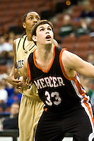 January 9, 2009:     Mercer forward Daniel Emerson (33) fights for rebound position in Atlantic Sun Conference action between the Jacksonville Dolphins and the Mercer Bears at Veterans Memorial Arena in Jacksonville, Florida.  Jacksonville defeated Mercer 80-59.