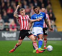 Lincoln City's Harry Anderson vies for possession with Macclesfield Town's Zak Jules<br /> <br /> Photographer Chris Vaughan/CameraSport<br /> <br /> The EFL Sky Bet League Two - Lincoln City v Macclesfield Town - Saturday 30th March 2019 - Sincil Bank - Lincoln<br /> <br /> World Copyright © 2019 CameraSport. All rights reserved. 43 Linden Ave. Countesthorpe. Leicester. England. LE8 5PG - Tel: +44 (0) 116 277 4147 - admin@camerasport.com - www.camerasport.com