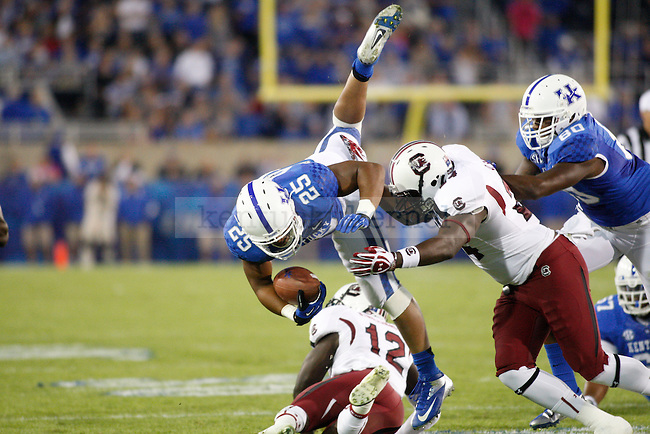 Kentucky Wildcats running back Jonathan George (25) during the first half of the University of Kentucky football vs.  South Carolina at Commonwealth Stadium in Lexington, Ky., on Saturday, September 29, 2012. Photo by Tessa Lighty | Staff