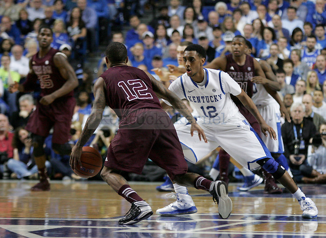 Freshman guard Ryan Harrow sits down and guards junior guard Fabyon Harris during the second half of the Men's Basketball game vs. Texas A&M at the Rupp Arena in Lexington, Ky., on Saturday, January 12, 2013..