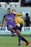Tom Pope of Port Vale and Greg Taylor of Cambridge United during Cambridge United vs Port Vale, Sky Bet EFL League 2 Football at the Cambs Glass Stadium on 9th February 2019