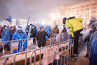 Independence Square under a heavy snowfall is blocked from all sides by barricades. The city prepares for a forced evacuation tonight. The police authorities are planning to forcedly evacuate the streets from the protesters blocking all the government buildings. Kiev. Ukraine
