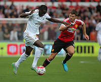 Pictured: Eder of Swansea (L) Sunday 30 August 2015<br /> Re: Premier League, Swansea v Manchester United at the Liberty Stadium, Swansea, UK