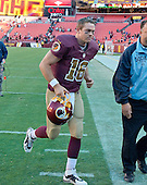 Washington Redskins quarterback Colt McCoy (16) leaves the field following the game against the Tennessee Titans at FedEx Field in Landover, Maryland on Sunday, October 19, 2014.  McCoy entered the game after halftime and led his team to victory. The Redskins won the game 19 - 17.<br /> Credit: Ron Sachs / CNP