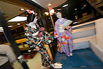 "Geisha are welcomed aboard one of Harumiya Co.'s ""yakata-bune"" pleasure boats toward central Tokyo, Japan on 30 August  2010. Photographer: Robert Gilhooly"