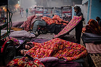 OLD DELHI, INDIA, JANUARY 11, 2016: Men sleep covered by rented blankets at sleep market on January 11, 2016 in Old Delhi, India. <br /> Daniel Berehulak for The New York Times