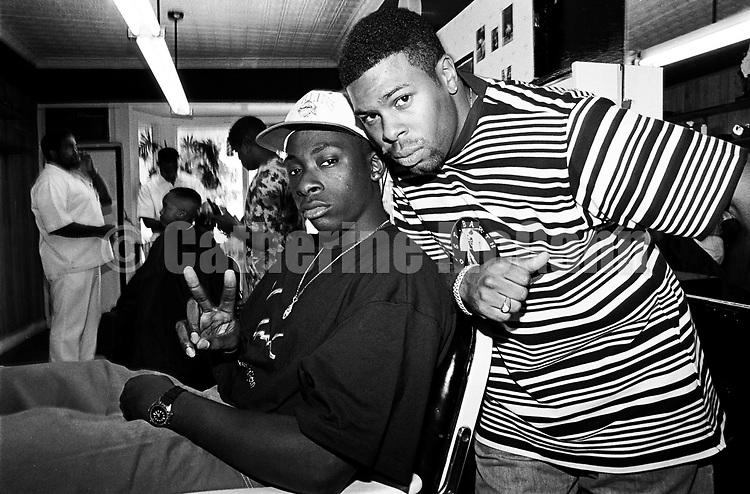 MT. VERNON - JULY 1992:  American rappers Pete Rock & C.L. Smooth  pose for a portrait in July 1992 at a barber shop in Mount Vernon, New York. Pete Rock (born Peter Phillips) on left, C.L. Smooth (born Corey Penn) on right.  (Photo by Catherine McGann).Copyright 2010 Catherine McGann