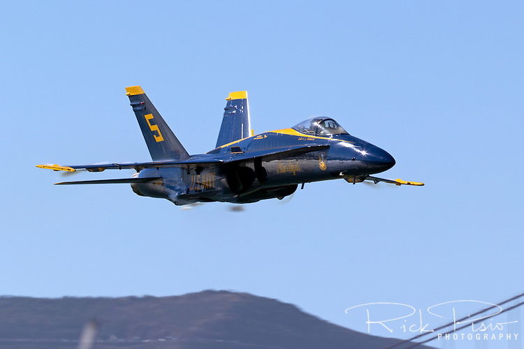 The United States Navy Blue Angel's Lead Solo demonstrates the element of surprise during a sneak pass maneuver.