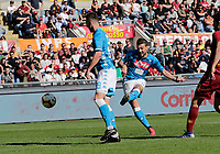 Simone Verdi of Napoli shoots and scores during the  italian serie a soccer match, AS Roma -  SSC Napoli       at  the Stadio Olimpico in Rome  Italy , March 31, 2019
