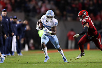 RALEIGH, NC - NOVEMBER 30: Javonte Williams #25 of the University of North Carolina runs the ball during a game between North Carolina and North Carolina State at Carter-Finley Stadium on November 30, 2019 in Raleigh, North Carolina.